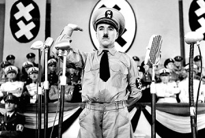 """085007_1.tif. ** FILE **Legendary silent film actor/director Charlie Chaplin is shown in a scene from the 1940 film """"The Great Dictator,"""" his first film with dialogue, in this promotional photo. Chaplin plays the dual roles of a sweet-natured Jewish barber and a murderous Hitler-type dictator. Four of Chaplin's films """"The Gold Rush,"""" """"The Great Dictator,"""" """"Modern Times,"""" and """"Limelight,"""" are being released on DVD July 1, 2003, from Warner Home Video, as the first in a series of ten titles included in """"The Chaplin Collection."""" (AP Photo/The Roy Export Company Establishment, HO)"""